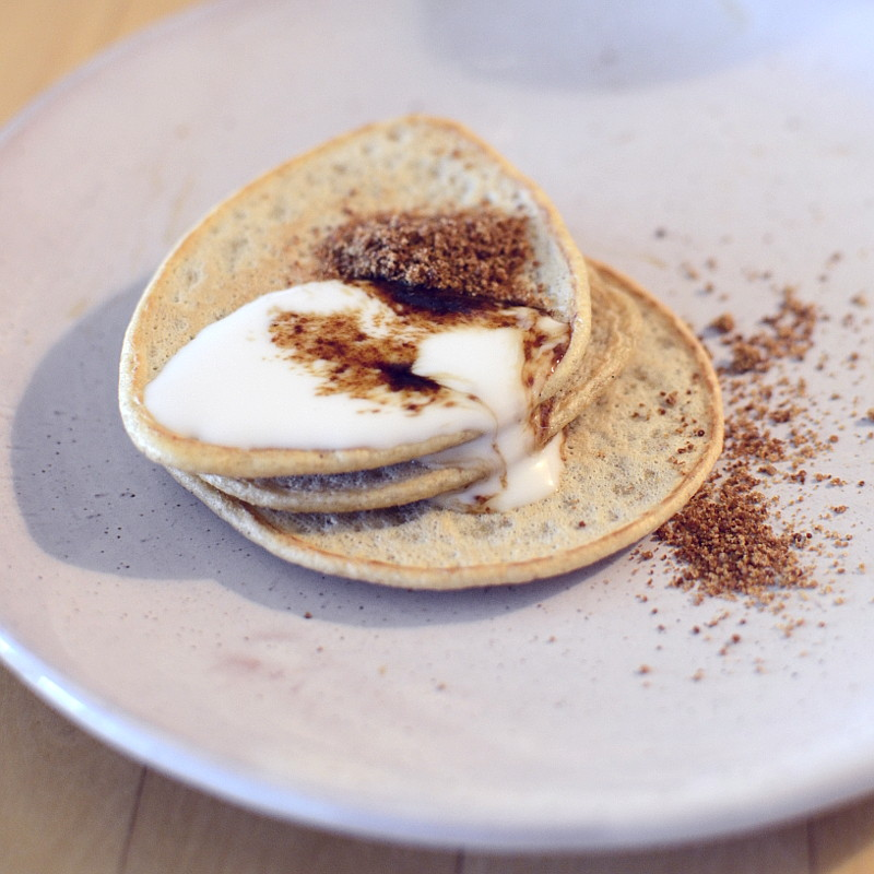 Same nice and yummy decoration on three pancakes stacked with soy cream melting on their edge